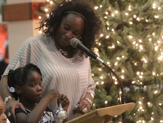 Renee Wimberly and her granddaughter hang an ornament