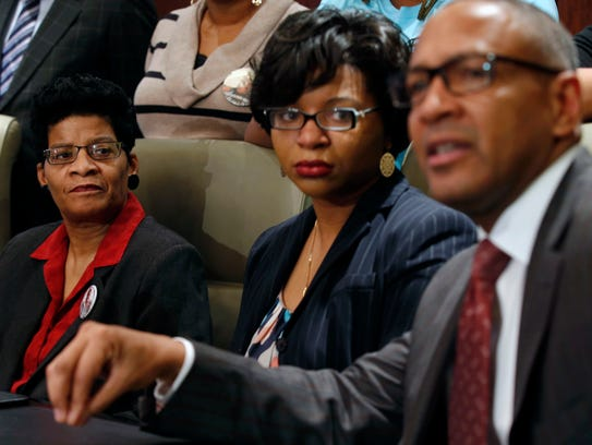 Geneva Reed-Veal, left, and Sharon Cooper, center,
