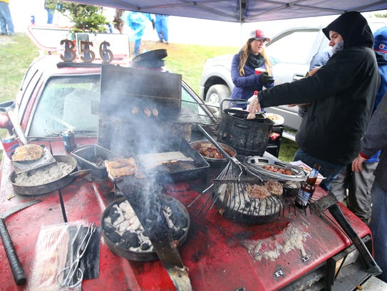 Food is cooked on the hood of an old Pinto at thePinto