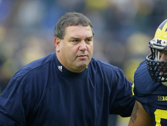 Michigan football coach Brady Hoke gets ready for a