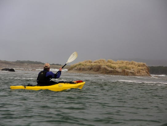 Joshua Uithof of Kayak Tillamook paddles through Sand