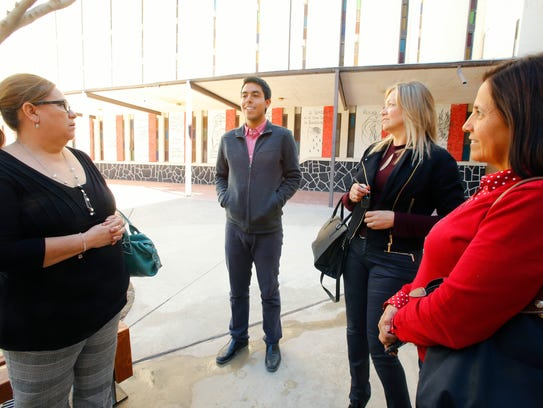 First-year seminary student Erick Molina visits with