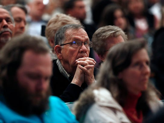 Audience members listen to Ted Cruz speak during a