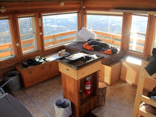The inside of Hager Mountain Lookout is cozy with bunks,