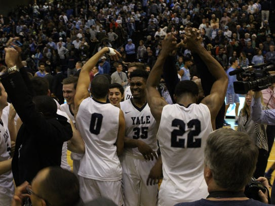 Yale players celebrate after securing the Bulldogs'