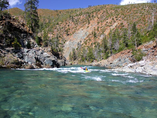 Peter Gandesbery kayaks down the North Fork of the