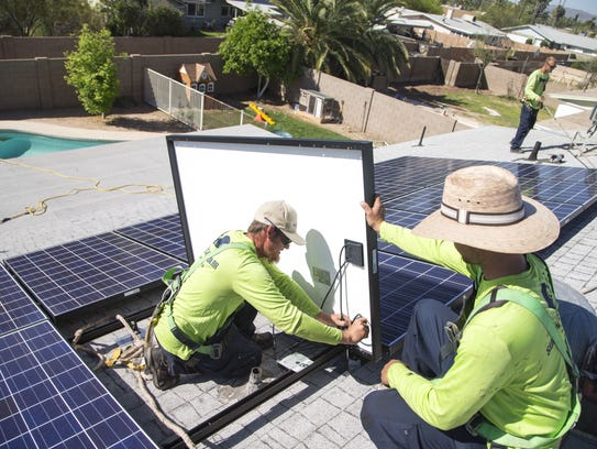 Sun Valley Solar Solutions workers Robert Cogswell,
