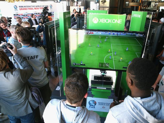 Players compete in the FIFA Interactive World Cup 2016