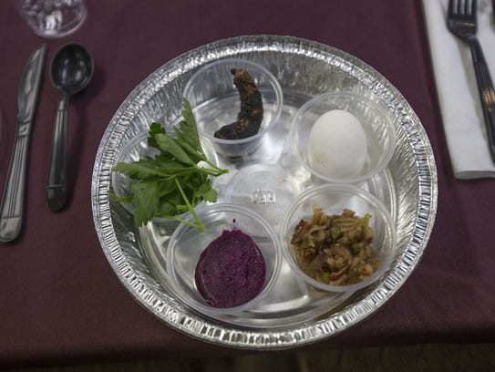 Yehoshua Bedrick sets up a seder plate before Passover