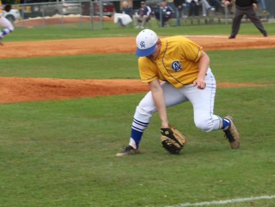 Clarksville Academy pitcher Michael Conn reaches down