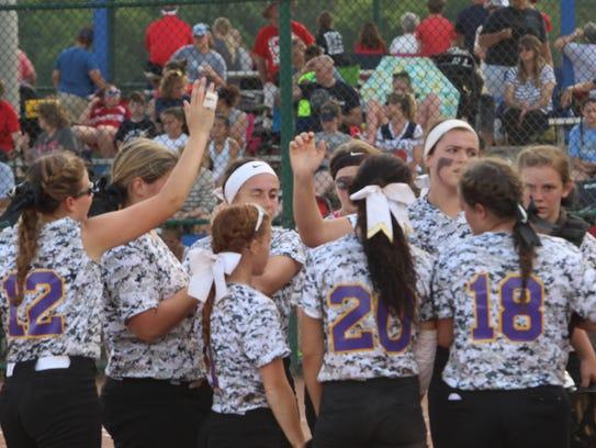 Clarksville High's softball team gathers near their