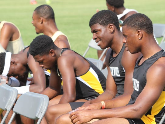 Kenwood's 4x200-meter relay team waits to be called