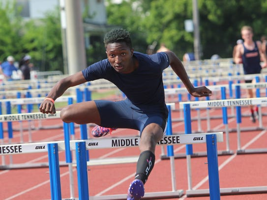 Northeast's Trevor Young competes in the boys 110-meter