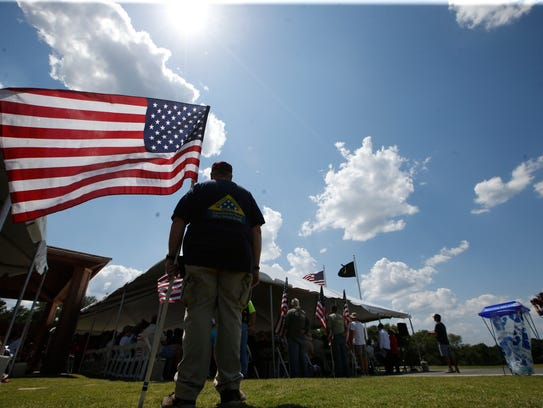 File art of a Memorial Day observance at Tallahassee National Cemetery.