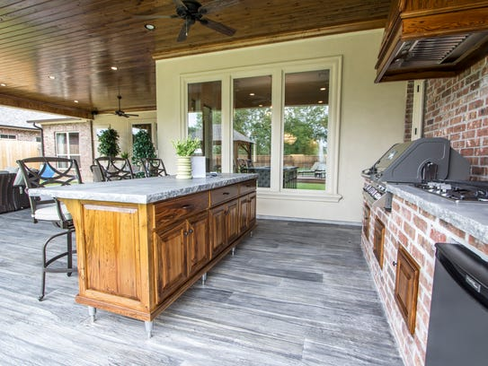 There is a large outdoor kitchen with space enough