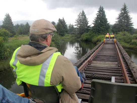 Matt Achor rides an Oregon Coast Railrider across a