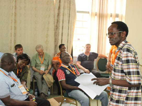 Robert Mwanga of Uganda, speaks in a mentoring workshop.