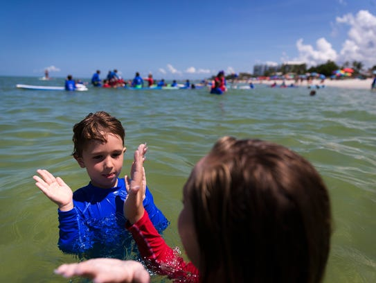 Ocean Kids summer camp participant Luca Hains, 5, left,
