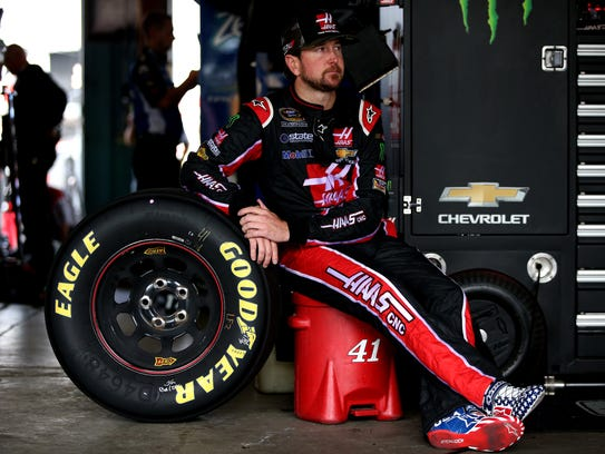 Kurt Busch sits in the garage during practice for the