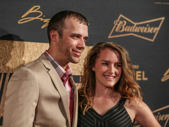 IndyCar driver Bryan Clauson and Lauren Stewart walk
