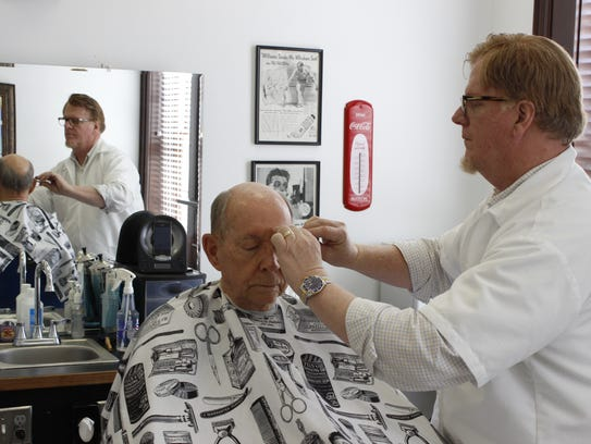 Sam Birch, the Atlanta-based barber who opens shop