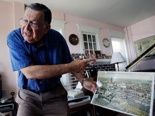 Piano tuner Charlie Birnbaum of Hammonton stands in