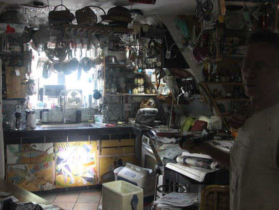 Larry Bosco stands in the dark kitchen of his Levy