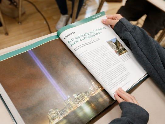 Freshman Emma Butterworth looks over a textbook that
