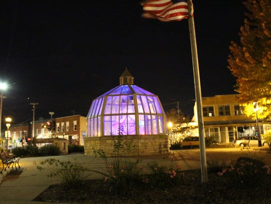Purple lights illuminate the Neumann Water Dome at