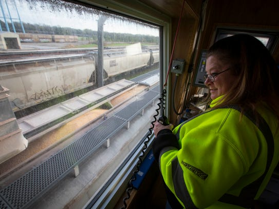 Kim Collins directs the train and corn loading at Heartland