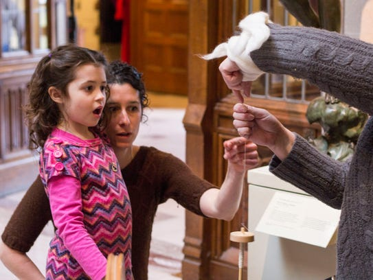 Young community member in awe of the artist during
