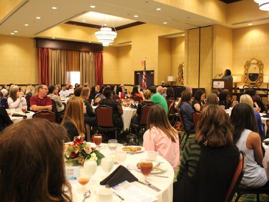 A room full of community members, educators and students