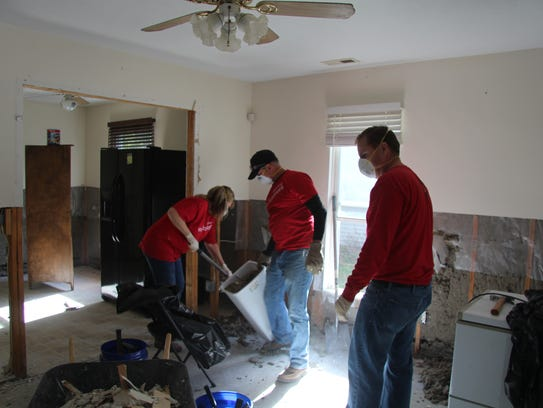 Volunteers from Wells Fargo bank work on cleaning up