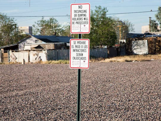 "A ""no trespassing"" sign marks a city-owned gravel lot"