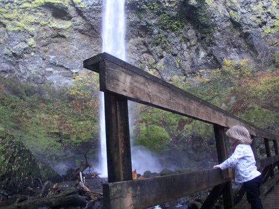 Lucy Urness looks at Elowah Falls.