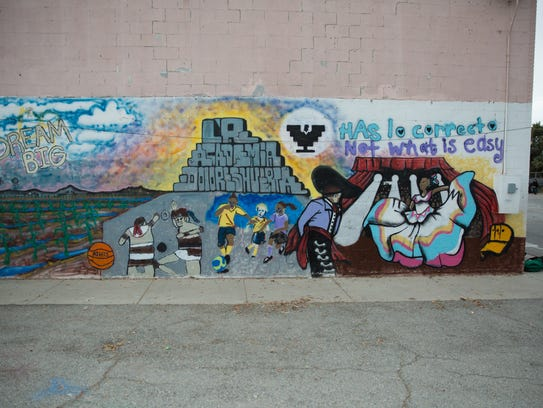 A mural on the side of La Academia Dolores Huerta