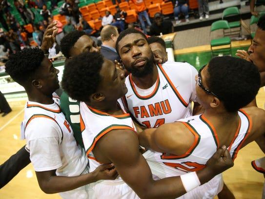 Derrick Dandridge (center) is one of three players