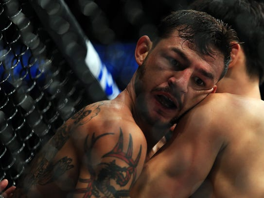 Cub Swanson (L) wrestles with Doo Ho Choi in their