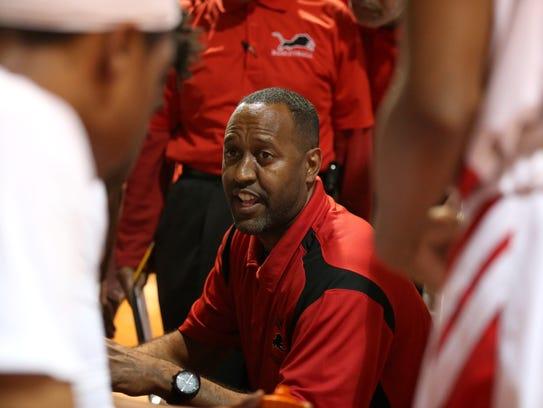 Leon Head Coach Rick Davis talks to his team during