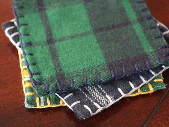 Plaid flannel coasters add a cozy touch to the coffee