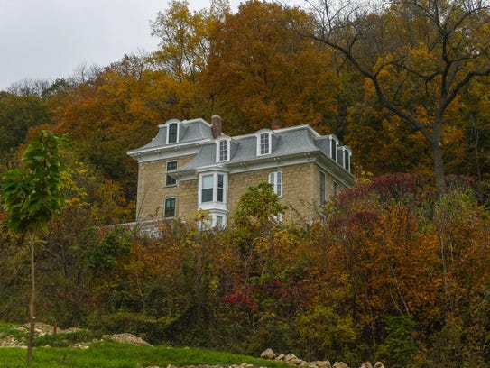 A house is nestled into colorful foliage on Monday,