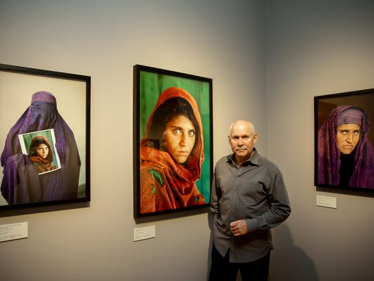 "Photographer Steve McCurry with his portraits of ""Afghan"