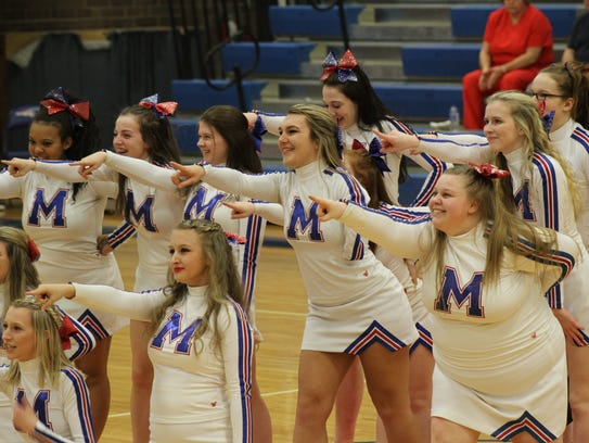 The Madison cheerleaders entertain during a break in
