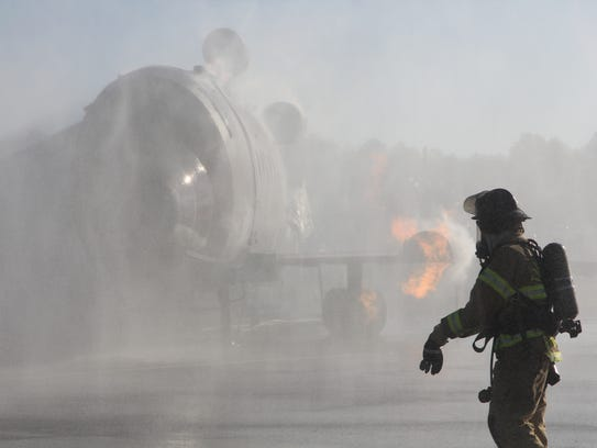 A Tallahassee Firefighter assesses a blaze in a mock