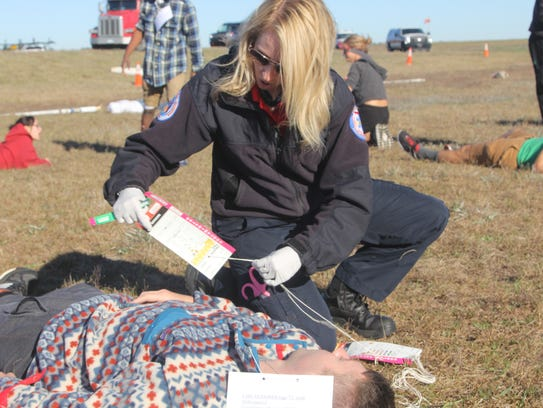 """A paramedic tends to a plane crash """"victim"""" during"""