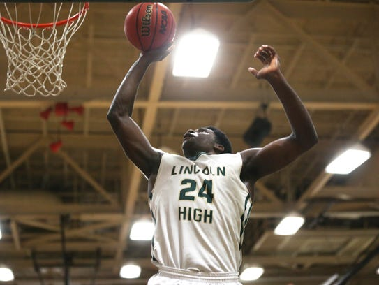 Lincoln's Dwight Wilson grabs a rebound and puts it