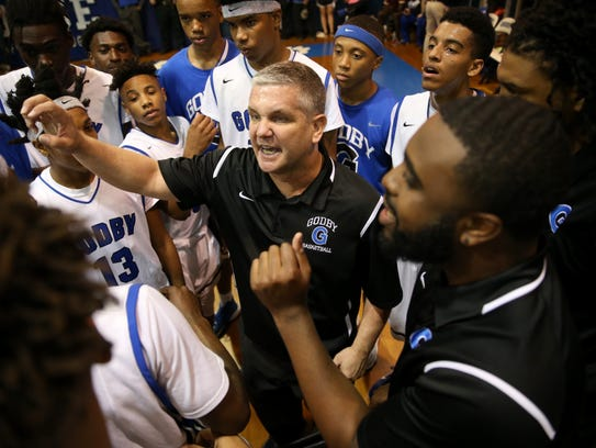 Godby Head Coach Andrew Colville talks to his team