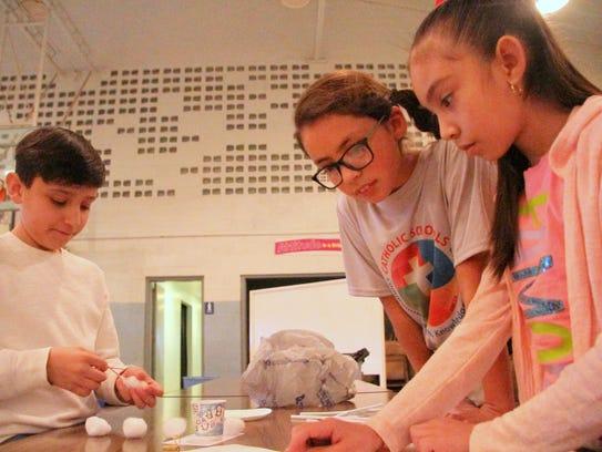 NWP engineers help students design at St. Edward Catholic