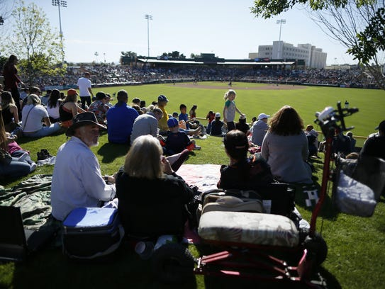 Fans watch from the lawn seats in right-center field