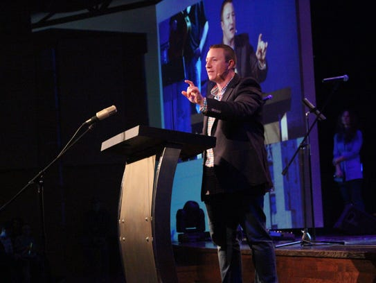 Lead pastor Dave Vance tells the congregation about